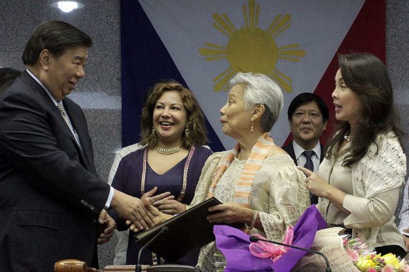 Senator Franklin M. Drilon (left) congratulates former Senate President Pro-Tempore Leticia Ramos Shahani (center) after the Senate passed on 10 June 2015, Resolution No. 1396 honoring her contributions as a legislator, diplomat, educator, women's rights advocate and civil society leader. Also in photo are Senator Loren Legarda (right) Senator Ferdinand Marcos Jr. (2nd from right) and the former senator's daughter, Lila Ramos Shahani (2nd from left). File photo/Alex Nueva España, Senate PRIB, NPPA